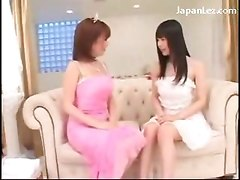 Young Asian Girl In White Dress Getting Her Pussy Licked By Older Girl On The Coach