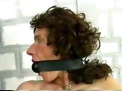 Two beautiful slaves with nice tits and wearing latex are locked in prison and got their pussy electroshocked by a police officier